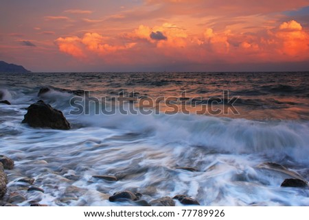Stormy sunset on a tropical sea - stock photo