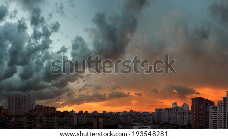 Stormy sunset sky. Twilight panoramic cityscape. Aerial view. Typical modern residential area.  - stock photo