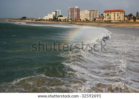 Stormy wave breaking across bay - stock photo
