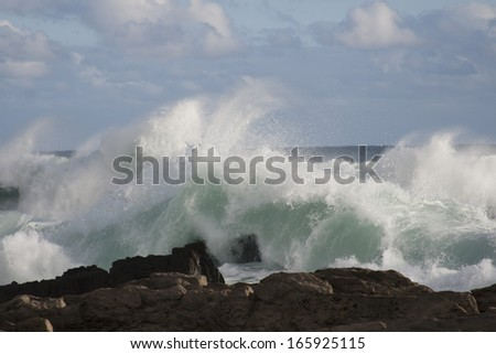 Stormy waves breaking on rocks at Storms River Mouth, Eastern Cape - stock photo