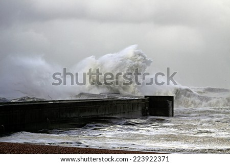Stormy waves over pier and beacon. North of Portugal. - stock photo