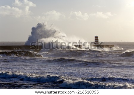 Stormy waves over pier, north of Portugal