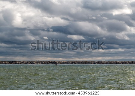 Stormy weather at the sea channel entrance - stock photo