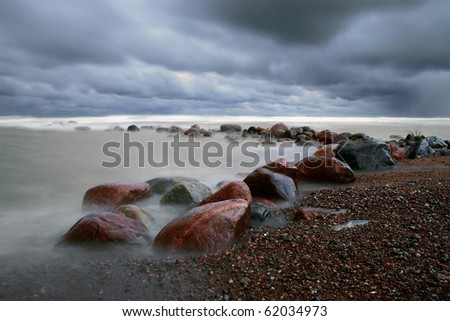 Stormy weather with mist waves in Baltic sea - stock photo