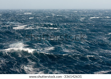 Stormy Winds Breaking Crests and Forming Streaks of Foam - stock photo