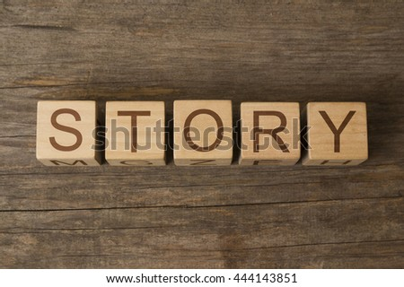 STORY word written on wooden cubes - stock photo
