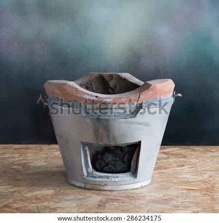 Stove equipment for kindle, on wooden plate - stock photo