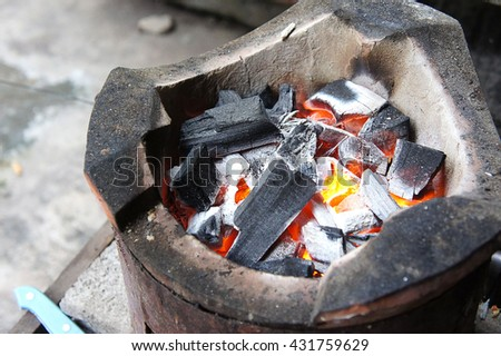 Stove, fireplace, cooker,An ancient fireplace that is still in use today. Used in cooking Fire for warmth - stock photo