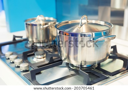 Stove with saucepan on the white modern kitchen - stock photo