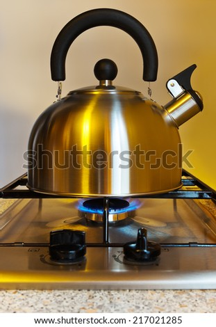 Stovetop whistling kettle - cooking kitchen background - stock photo