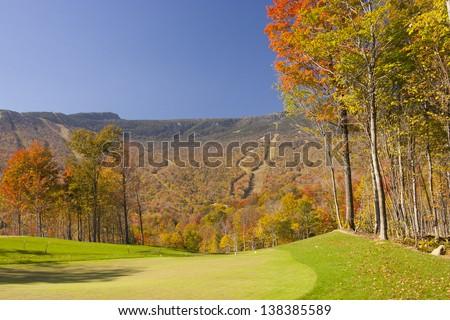 Stowe Mountain Resort ski trails during fall foliage season, Stowe Vermont, USA - stock photo