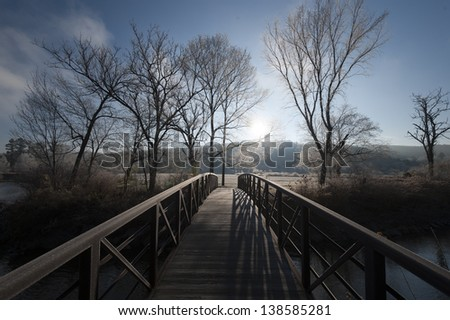 Stowe rec path walking bridge leading to frost covered trees, Stowe, Vermont, USA - stock photo