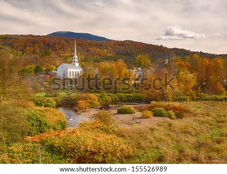 Stowe Vermont white church fall foliage - stock photo