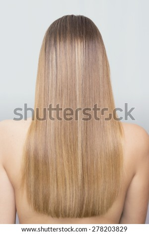 Straight blonde hair from behind