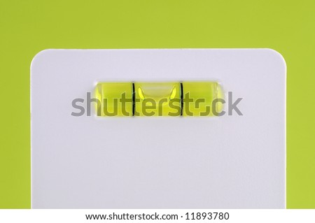 Straight card level against green background - stock photo