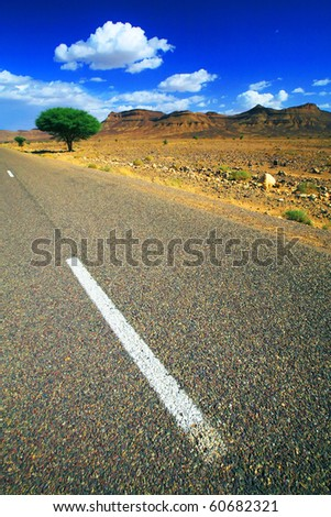 Straight desert road in Morocco, Africa - stock photo