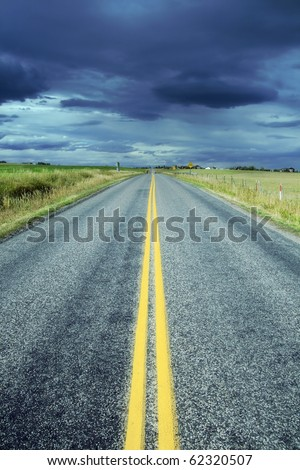 Straight Highway in Direction of a Storm - stock photo