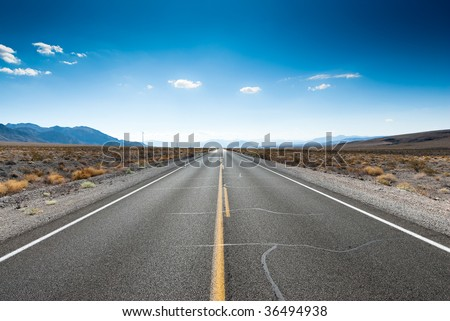 straight highway in sierra nevada, usa - stock photo