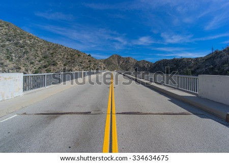 Straight highway leads through the Angeles National Forest outside Los Angeles California. - stock photo