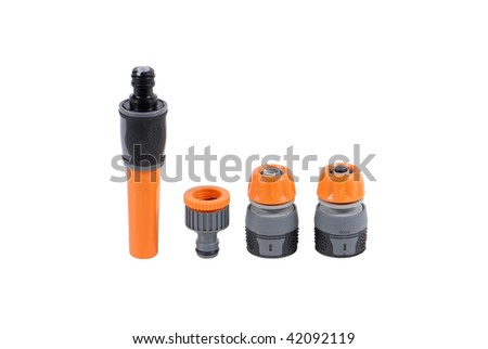Straight nozzle plus set of fittings isolated over white background - stock photo