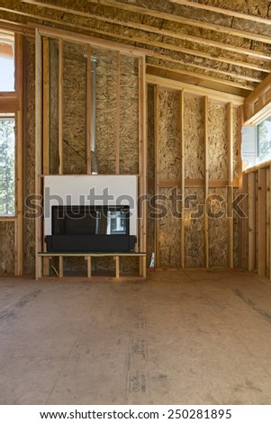 Straight On View of Home Construction and Fireplace Installation - stock photo