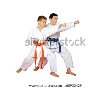 Straight punch hand in the performance of athletes on a white background
