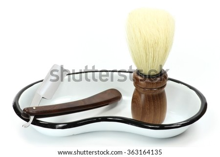 straight razor with accessories isolated on white background