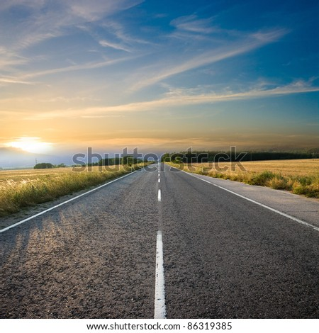 straight road and colorful sunset - stock photo