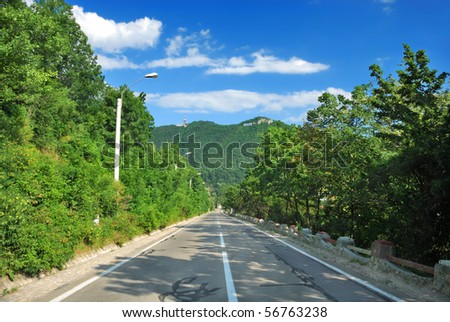 Straight road and leading lines to Tampa mountain in Brasov, Romania, Europe - stock photo
