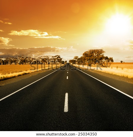 Straight Road at sunset in rural Australia - stock photo