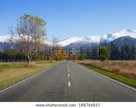 Straight road in Canterbury region, NZ - stock photo
