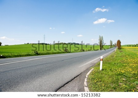 straight road in rural landscape - stock photo