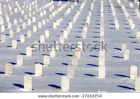 Straight rows of graves in winter at the Arlington National Cemetery in Virginia - stock photo