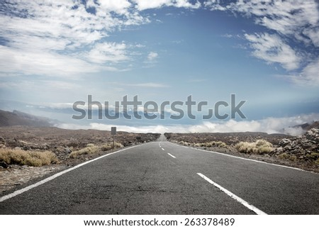 Straight rural road - stock photo