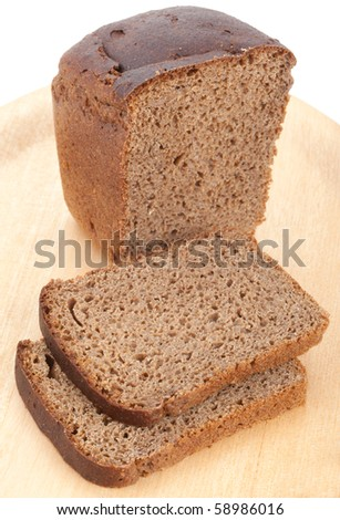 Straight rye bread on chopping board - stock photo