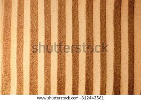 Straight stripes on sandy background - stock photo
