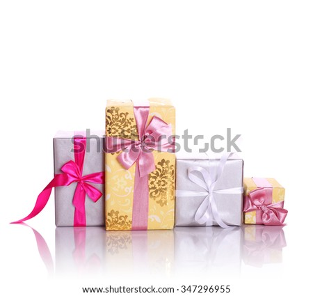 straight wrapped gift pile isolated on white background - stock photo