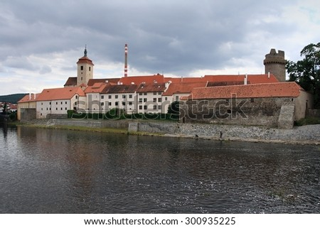 Strakonice Castle - landmark of the town Strakonice in the South Bohemian Region of the Czech Republic. A moated castle on the Otava River was built at the beginning of the 13th century. - stock photo