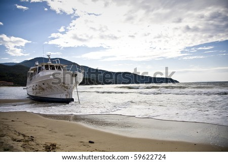 stranded boat after a storm - stock photo