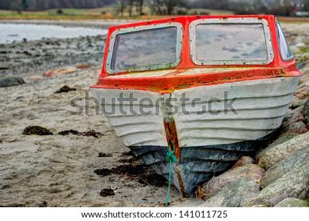 stranded boat on the beach in Denmark - stock photo