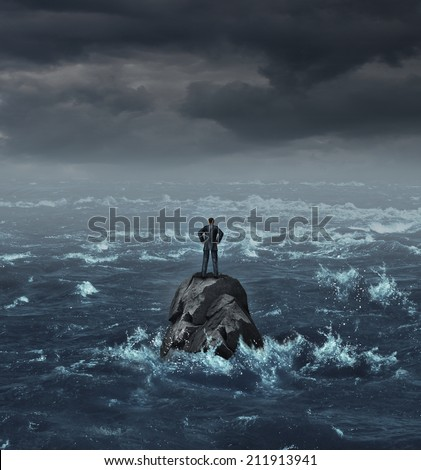 Stranded businessman lost at sea standing on an isolated rock as a business concept for financial despair or being lost and needing career or financial help to escape the crisis.