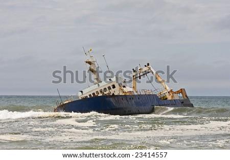 Stranded ship on the Namibian coast - stock photo