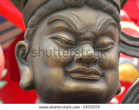 Strange expression on a chinese statue in thailand