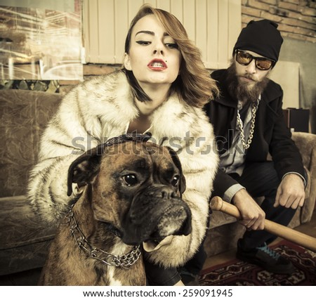 Strange family portait of rich couple and a strong pet. - stock photo