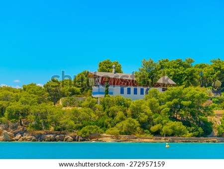 strange house by the sea in Spetses island in Greece - stock photo