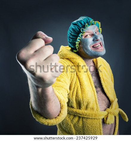 Strange man with face pack - stock photo