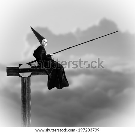 Strange person in black cloak fishing in the air. Black and white image - stock photo