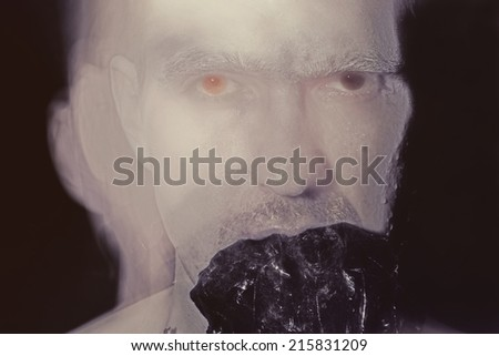 Strange portrait of a young man close-up - stock photo