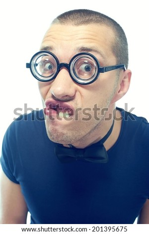 Strange, silly guy in eyeglasses with bow tie - stock photo