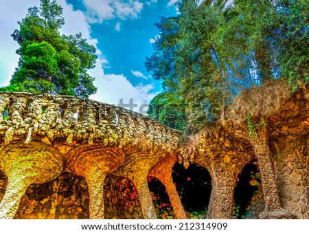 strange stone constructions in the famous park Guell at Barcelona in Spain. HDR processed - stock photo